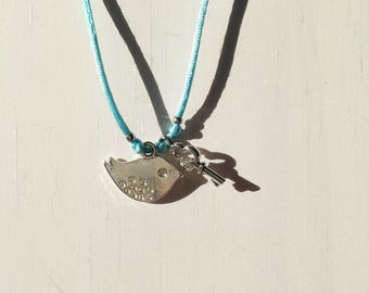 Silver bird and key turquoise cord necklace