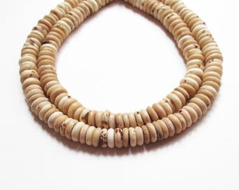 10 donuts coconut like 10 mm rondelle beads