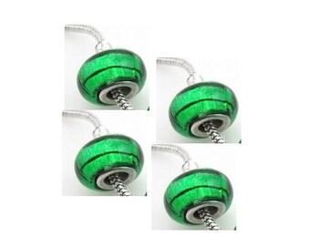Set of 4 glass green, shiny, black aspirales 14 mm x 9 mm beads