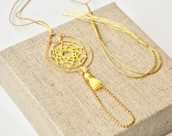 Gold ring, yellow Pompom and dream catcher necklace