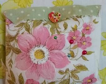 Pretty vintage pillowcase pincushion
