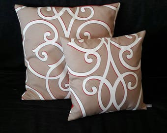 Red, white and light brown patterned with arabesques pillow cover for a chic decoration