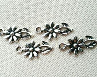 Set of 4 adorable Tibetan silver charms