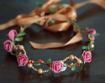 Crown of flowers and orange beads