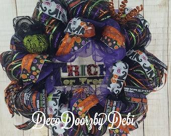 Halloween trick or treat wreath, multi color orange purple black deco mesh,  four premium Halloween ribbons  and glitter pumpkin & spiders