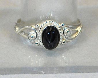 Ring in sterling silver with blackstar setting