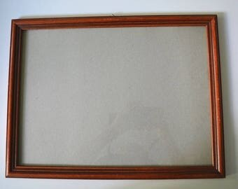 Vintage picture frame in dark wood with glass.