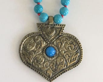 Turquoise necklace with brass tibetan pendant