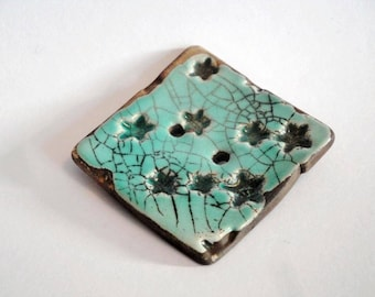 "Square button out of ceramics raku :  ""stars"", turquoise, 4 cm"