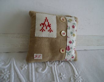 Embroidered initial cross stitch decorative door pillow has Monogram