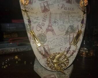 Birds in flight necklace