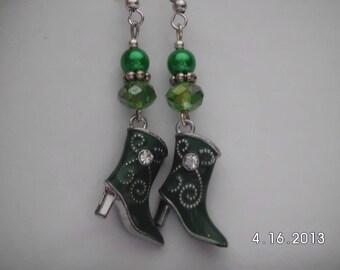 Green western boot earrings.