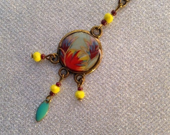 """Necklace """"Dreamcatcher"""" turquoise with red, yellow and lavender flowers."""