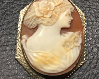 Artistic exquisite hand cut cameo set in 10 karat gold