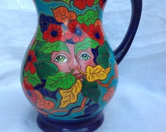 Handpainted upcycled Green Man jug in bright colours