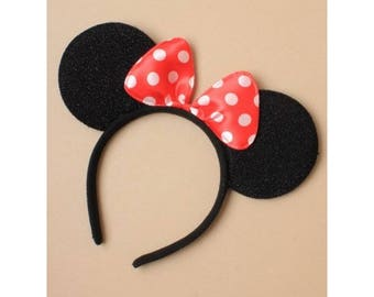 Black Mouse Ears. Black mouse ears with a satin red & white polka dot bow on an aliceband. Fits Adults and Children.
