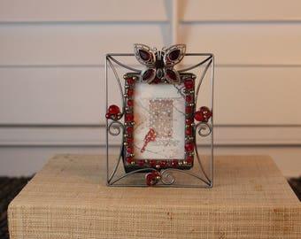 Butterfly embellished Silver frame.