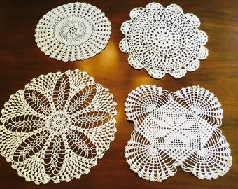Set of four hand made doilies.