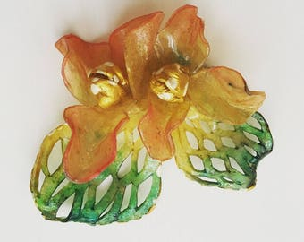 1920s old urea plastic orchid brooch