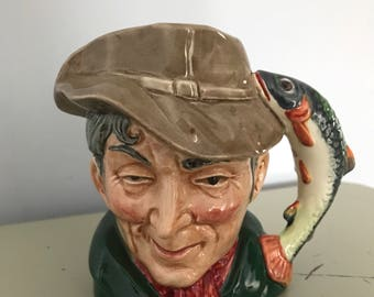 """Character Toby Jug, """"The Poacher"""" by Royal Doulton England. It has a Trout Fish Handle"""