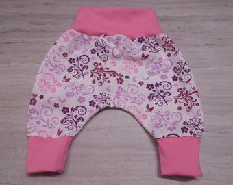 Sarouel bébé en coton fleurs rose et mauve avec ceinture rose