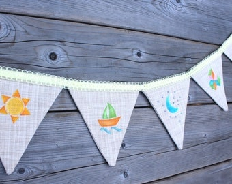 Garlands of flags painted and hand embroidered baby patterns. Duck. Boat. Sun. Children's room. Baby shower.