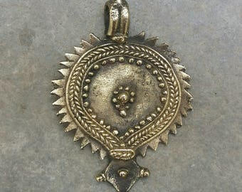 An antique hand made brass tribal pendant from Rajasthan Free shipping.