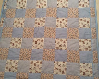 Baby boy quilt with teddy fabric