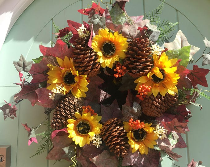 Sunflower and pinecone autumn door wreath