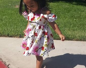 Off-shoulder summer floral dress for babies and toddlers.