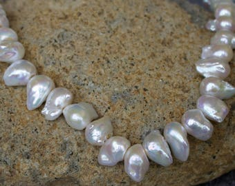 Unfinished Strand of Fresh Water Baroque Pearls.