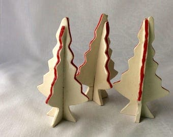 Ceramic Christmas trees. Red line.