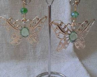 Butterfly and green rhinestone earrings