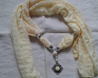 Yellow scarf and its print and flower jewelry