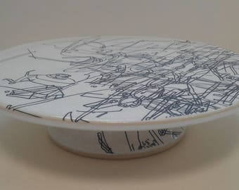 Ceramic pedestal plate and stand by Gosia Wlodarczak in collaboration with Maria Lieberman