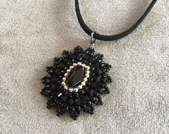 Black beaded pendant necklace with black leather chain