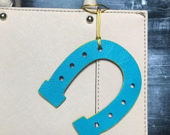Double sided horseshoe leather bag charm