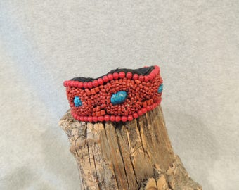 Red beaded cuff bracelet with turquoise accents