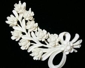 Celluloid carved vintage floral brooch