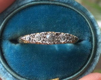 A Victorian Carved Diamond Five Stone Ring.