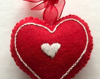 Hand embroidered hanging heart decoration.