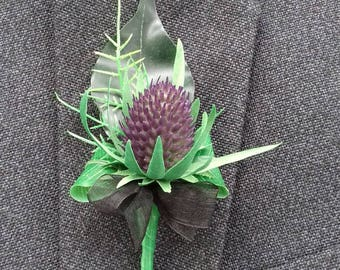 Realistic artificial Scottish thistle buttonhole with tartan or black organza finish