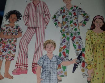 Simplicity uncut pattern size K5 7,8,10,12,14. Child and girls pajamas and nightgown in two lengths
