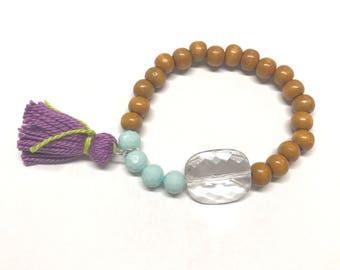 Blue, purple, and wood bead bracelet