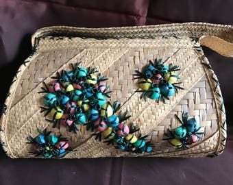 Woven purse with colorful seashell detail
