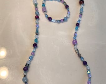 Healing of wisdom, balance ,& peace. Crystals, lavender-purple- white- and blue jade. Long necklace and matching bracelet