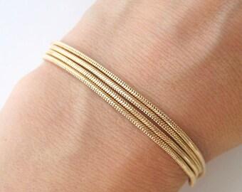 Multi strand gold 750/000 multistring bracelet 18 k