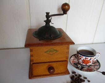 Vintage French coffee grinder.Retro coffee mill.Old coffee grinder.French coffee.Coffee shop decor.Traditional coffee grinder. Ideal gift.