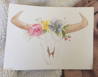 Watercolor cow skull with floral crown