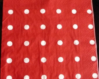 Red napkin with white polka dots
